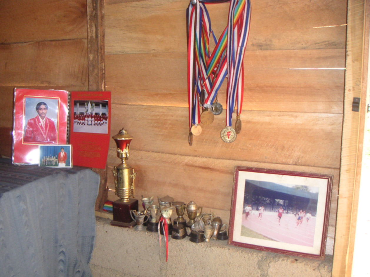 after the tsunami a young athlete gathered her trophies from the sand