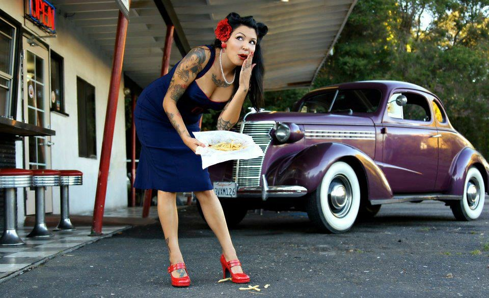 Miss Lolita Love  Vice President Photo Richelle Smith Photography  Miss Lolita love Born and raised in beautiful Northern California in a family full of Classic car owners, attending car shows was a natural thing. Her appreciation for the smell of exhaust, rocking Red lipstick and winged eyelinerbecame her signature look! Married to a Custom Car Restoration grease man, proud mamma and of course collector of tattoos, puts her smack in the middle of the kustom lifestyle she loves! Summertime is her favorite time of year, find her at Car shows, rockabilly concerts and of course the lakes!