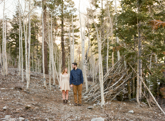 wooded teepee in the forest engagement session