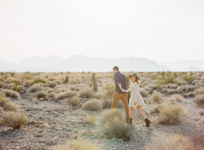 walking in the desert engagement photography