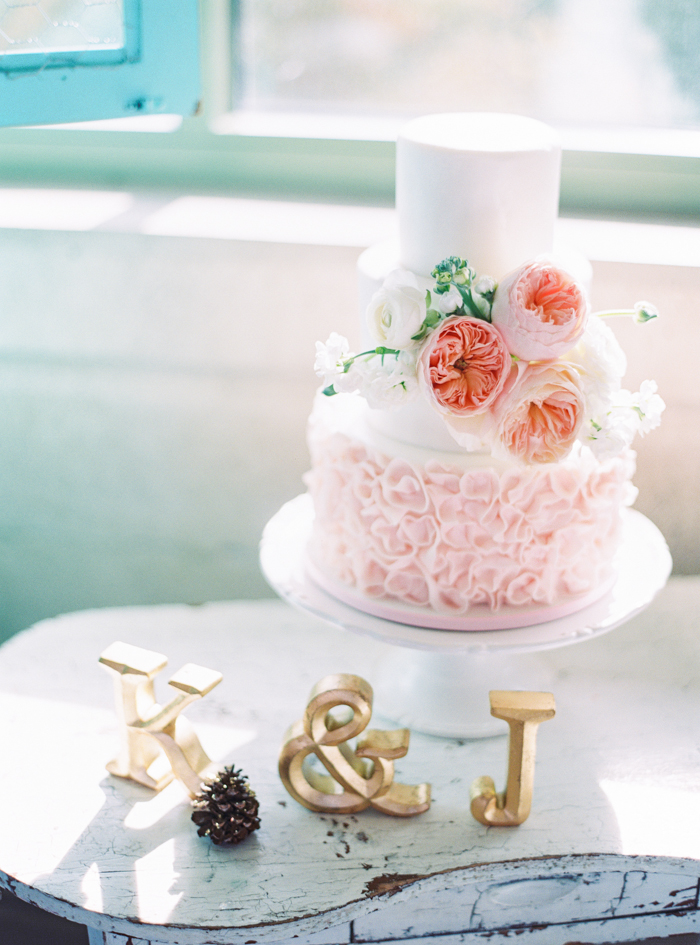 ruffled layers pink peonies wedding cake by Peridot Sweets