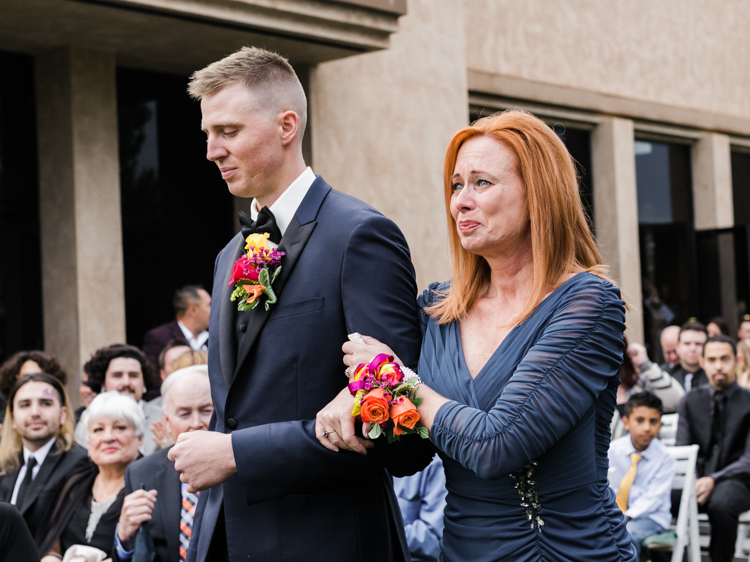 mom giving her son away wedding ceremony