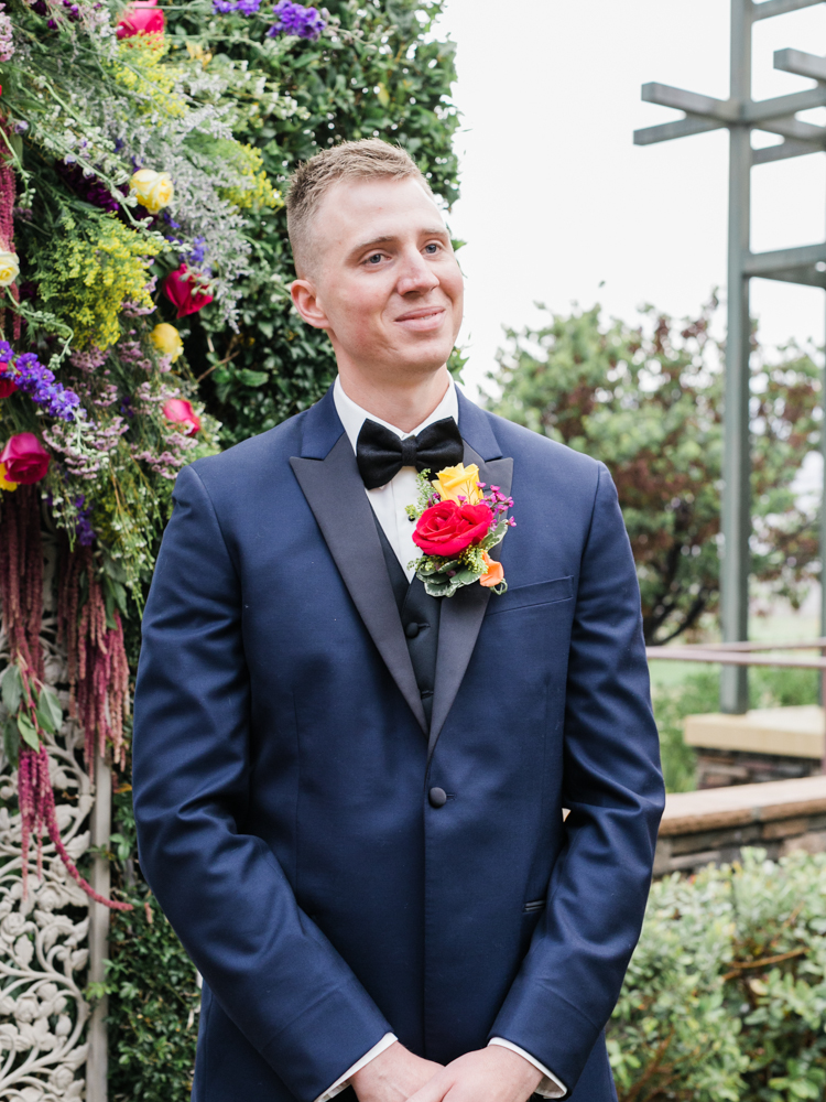 groom's smiling reaction seeing his bride walk down the aisle