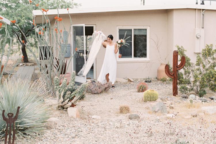 bride holding onto dress
