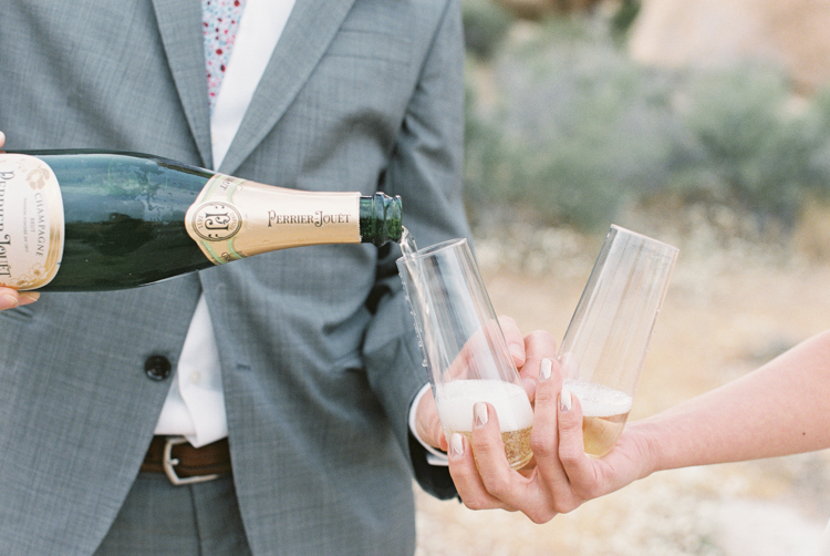 bride and groom drinking champagne after ceremony
