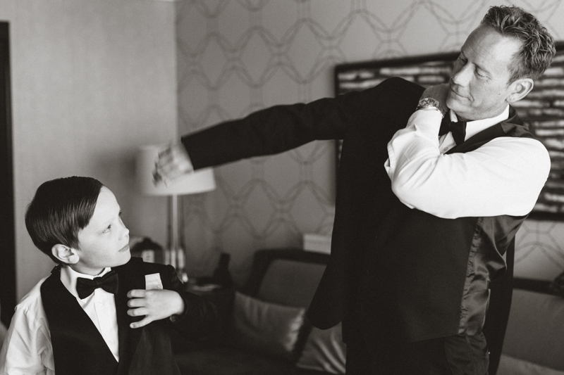 groom and son getting ready before wedding