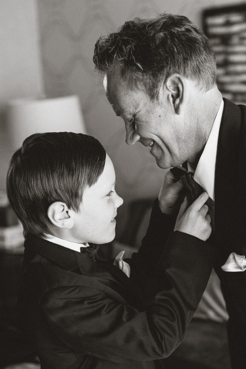 son helping dad with tie