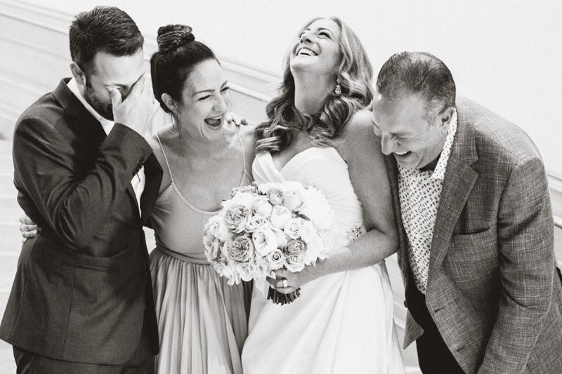 bride and wedding party laughing