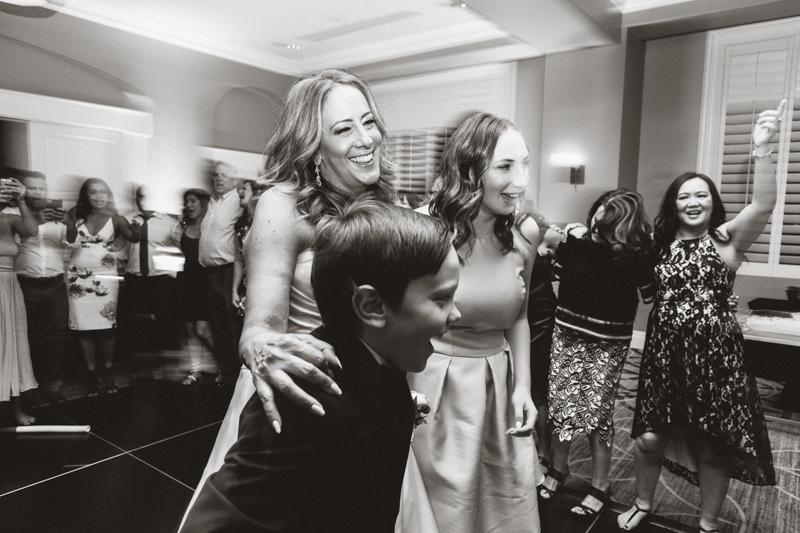 mom dancing with children wedding
