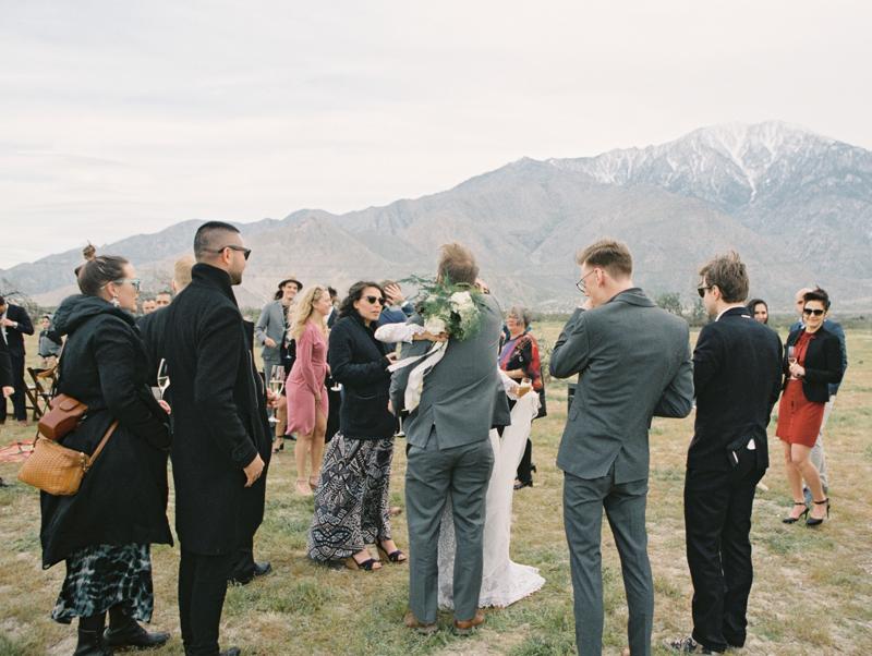 bride hugging guests during wedding