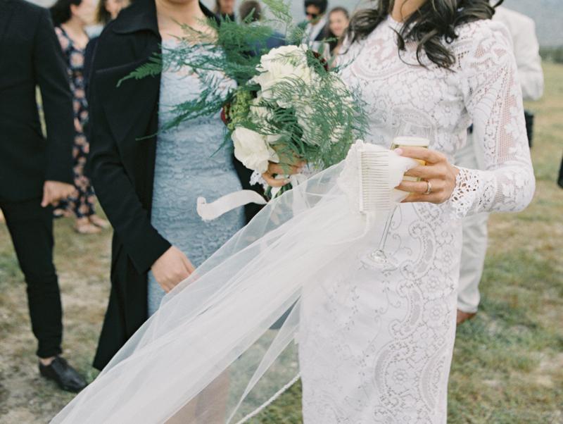 bride holding onto veil