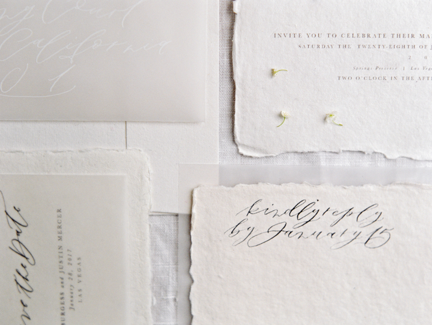 white on white wedding invitation calligraphy