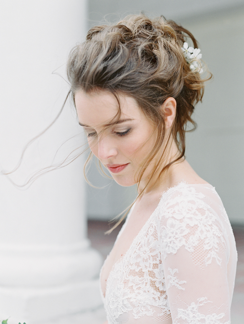 natural bridal updo with flowers in hair