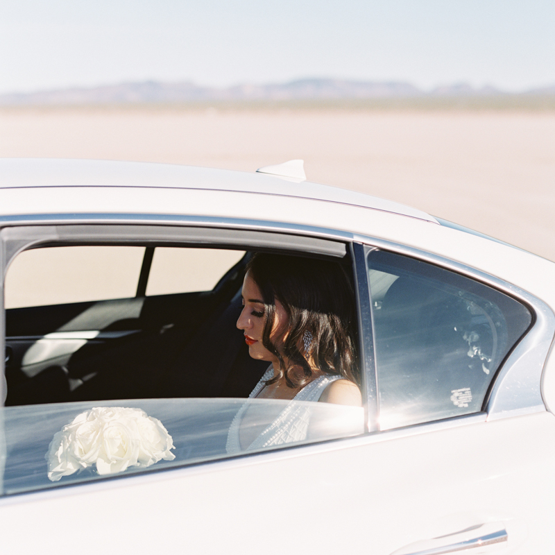 bride in car - dry lake bed wedding