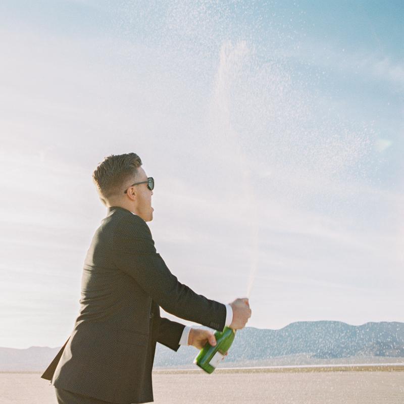 groom shaking champagne