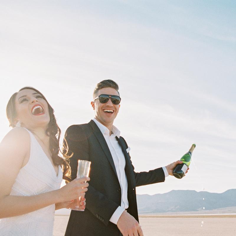 shaking champagne during wedding
