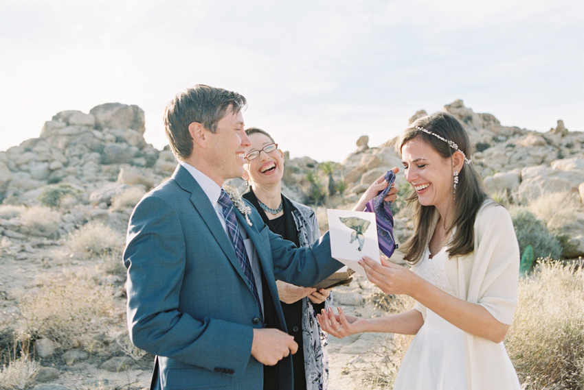 joshua tree national park wedding ceremony - groom wiping tears away from brides face