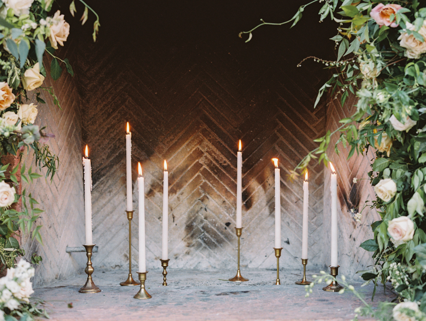 antique candle holders in fireplace for wedding ceremony altar