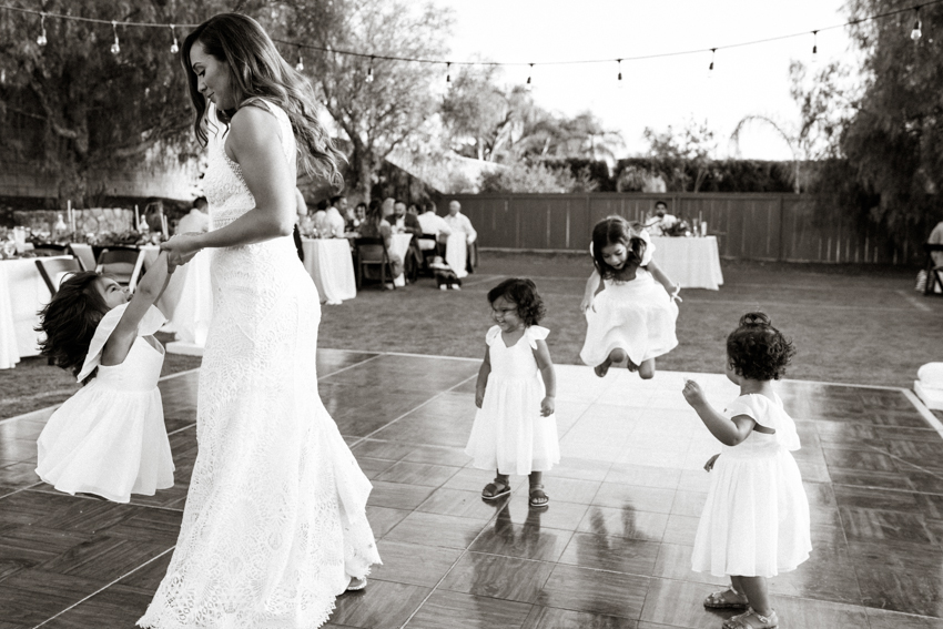 bride dancing with her flower girls