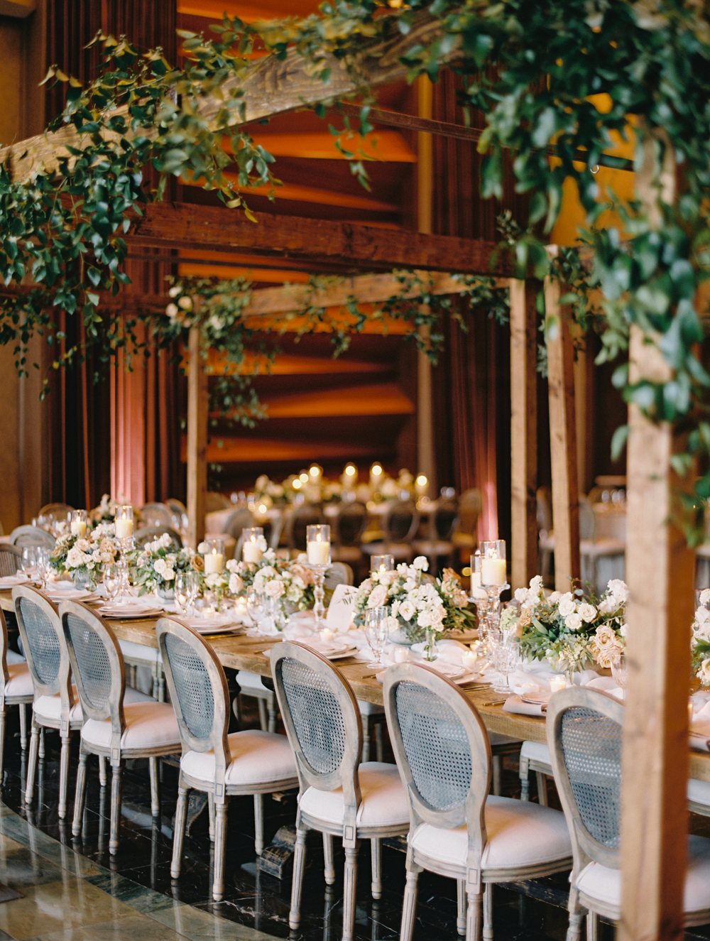 wooden cabanas with greenery wedding reception