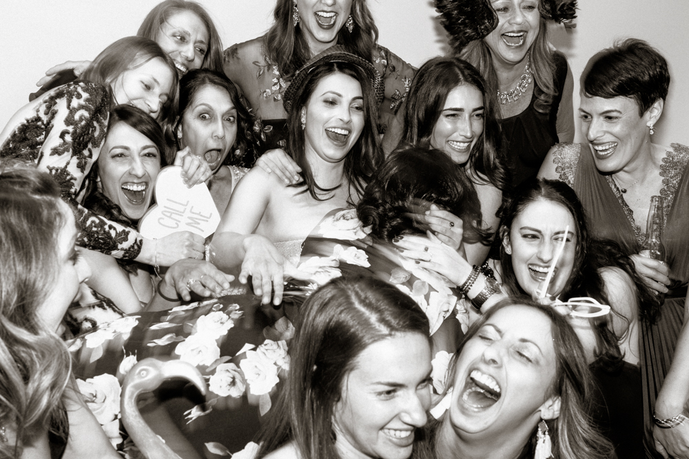 wedding party crashing photobooth having fun