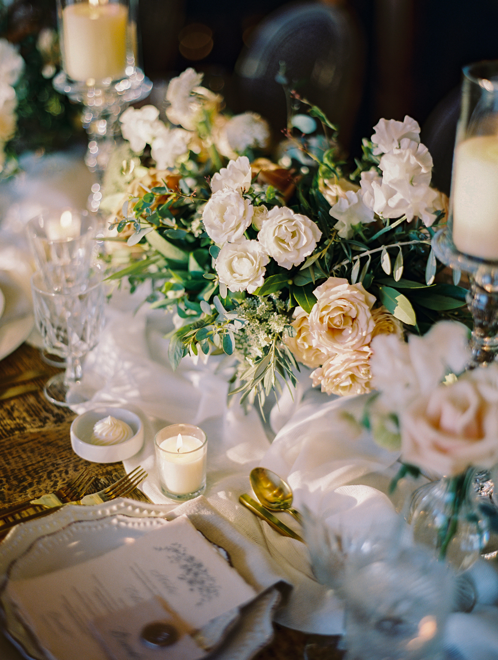 romantic wedding reception with candles and garden florals