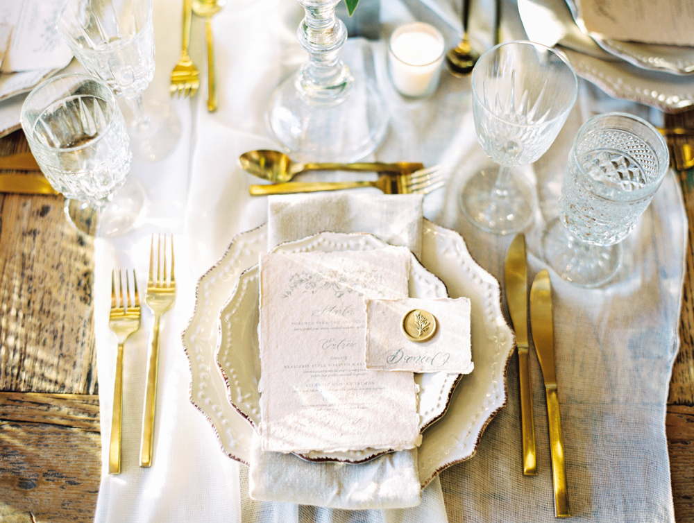 romantic wedding reception wedding reception tabletop gold flatware and dinnerware