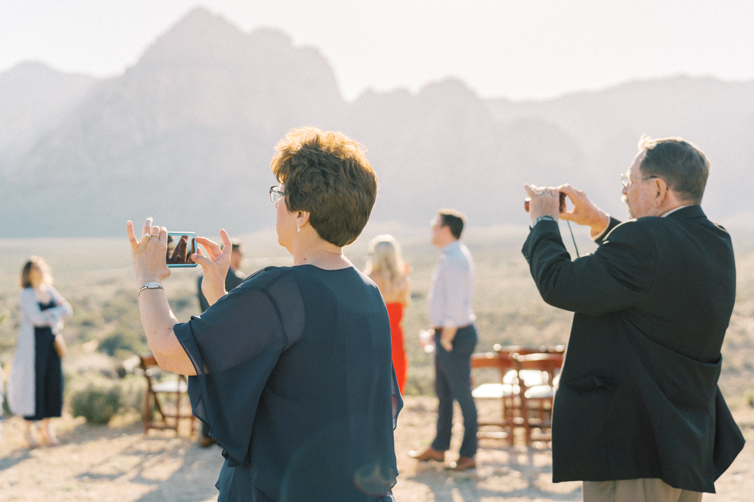 guests taking photos during wedding
