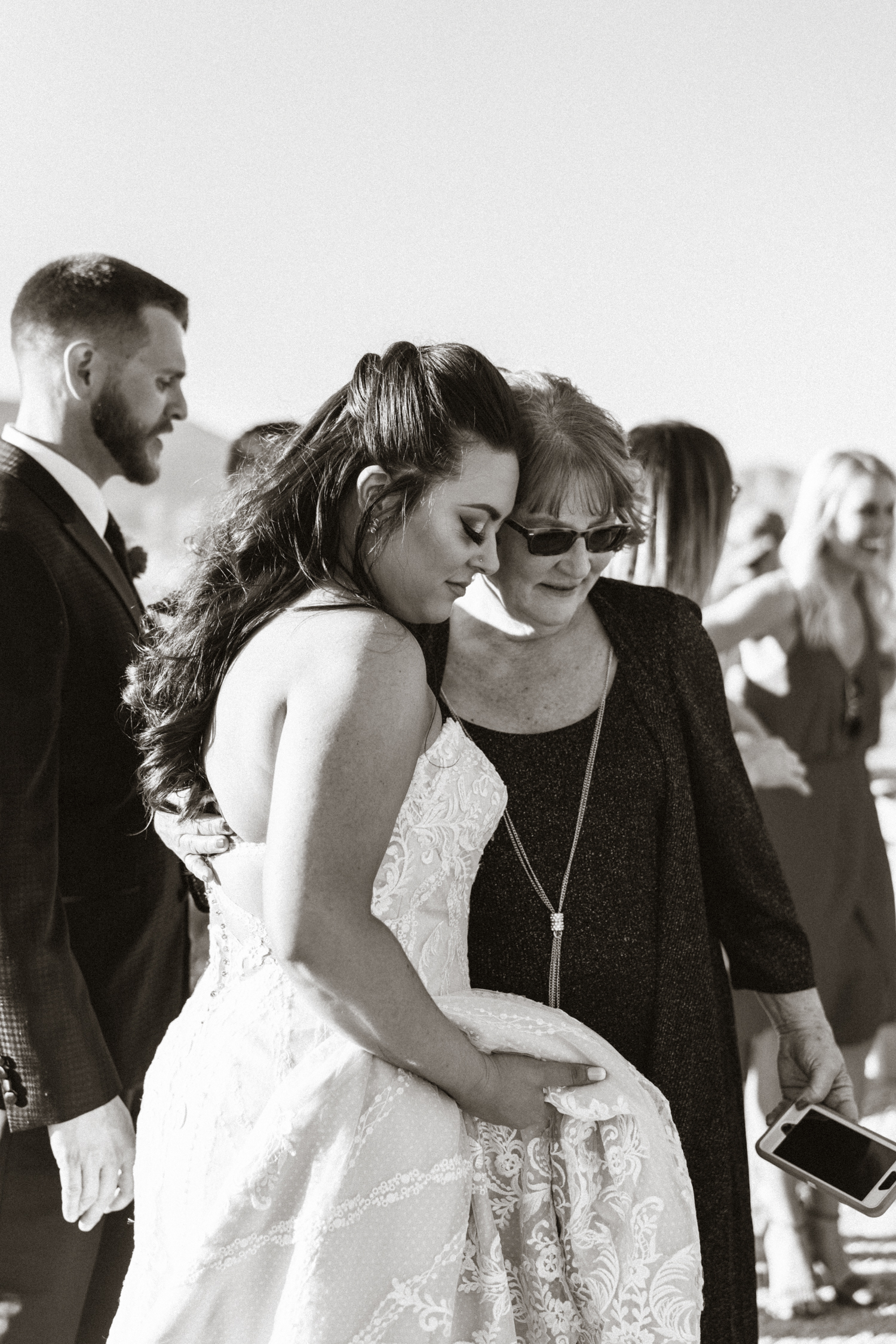 bride sharing a tender moment with her mother