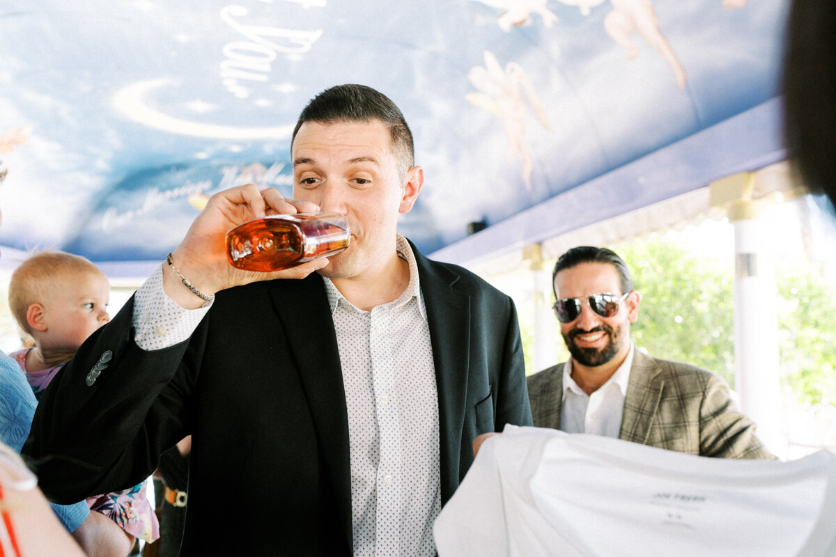 groom drinking right after the ceremony