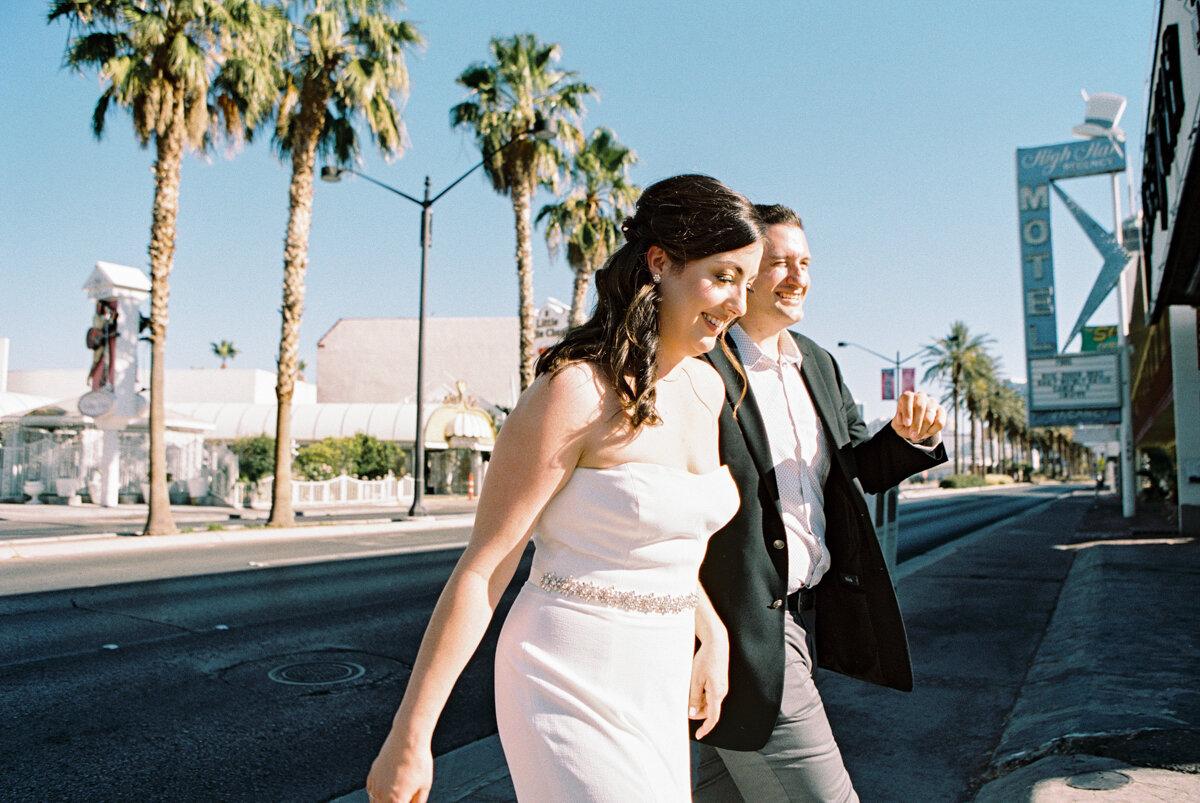 bride and groom walking on las vegas blvd