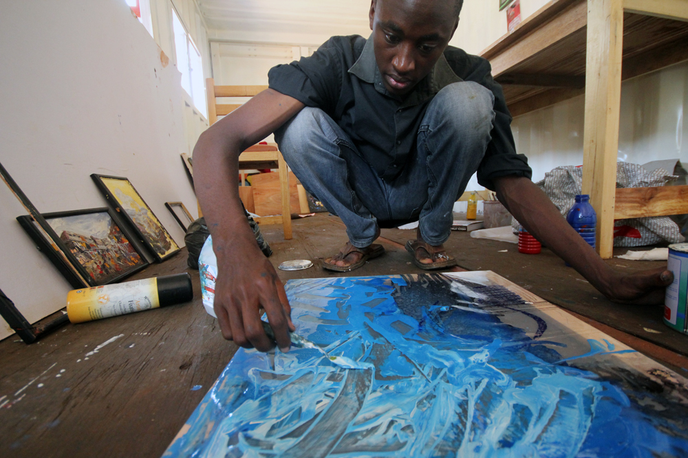 Ian Mwesiga in his studio during a three month residency in 2013
