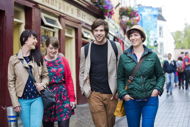 small-A group strolling through High Street in Galway city.jpg