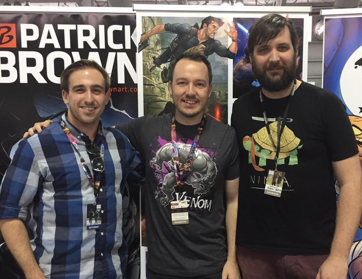 Kyle posing for a photo with his artistic inspiration, Patrick Brown (center) and Australian cartoonist Bobby Baxter (right) at the NYCC.