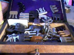 box of vintage violin mutes