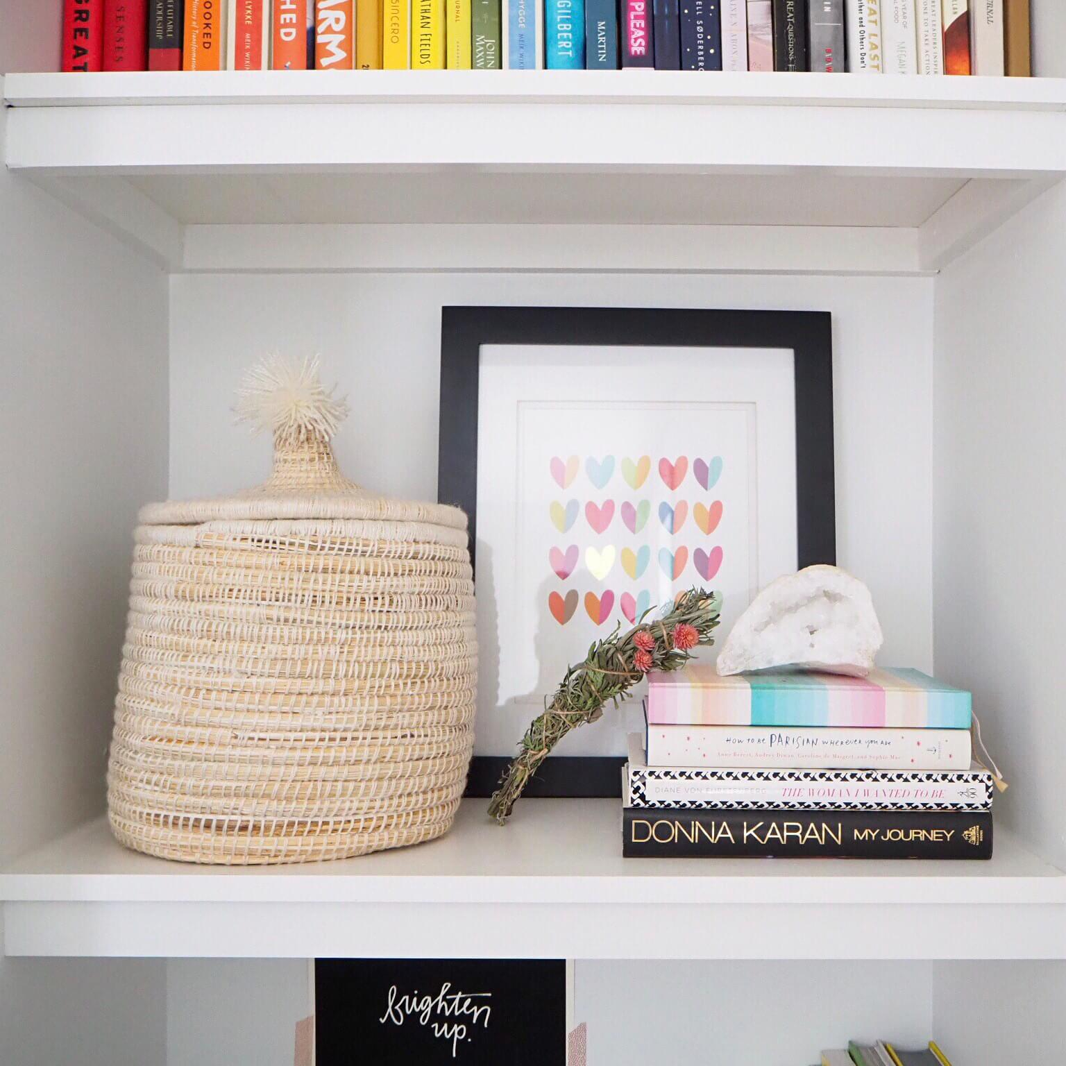 My actual bookshelf in my office. I layered up a framed print, a moroccan basket, rosemary smudge stick, some fantastic books and a personal journal, and a crystal for texture.