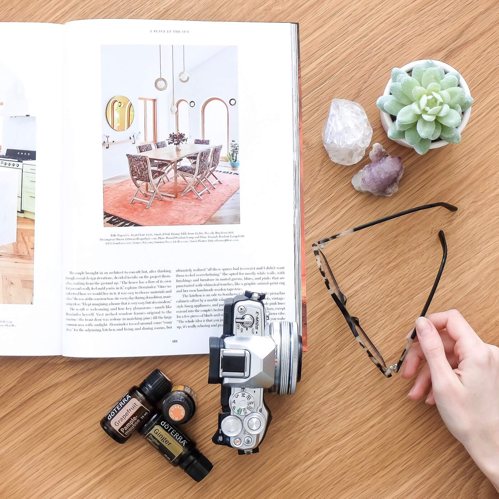 A lovely page from a Dwell magazine, a few of my crystals, a fake succulent, my own glasses and camera (and hand!), and one of my favourite essential oil diffuser blends.