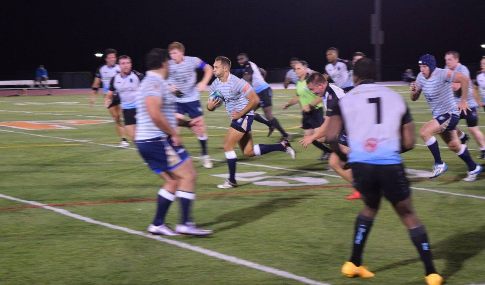 Arber Cojab splitting the defense set up Tristan Leclere for his second try of the night.