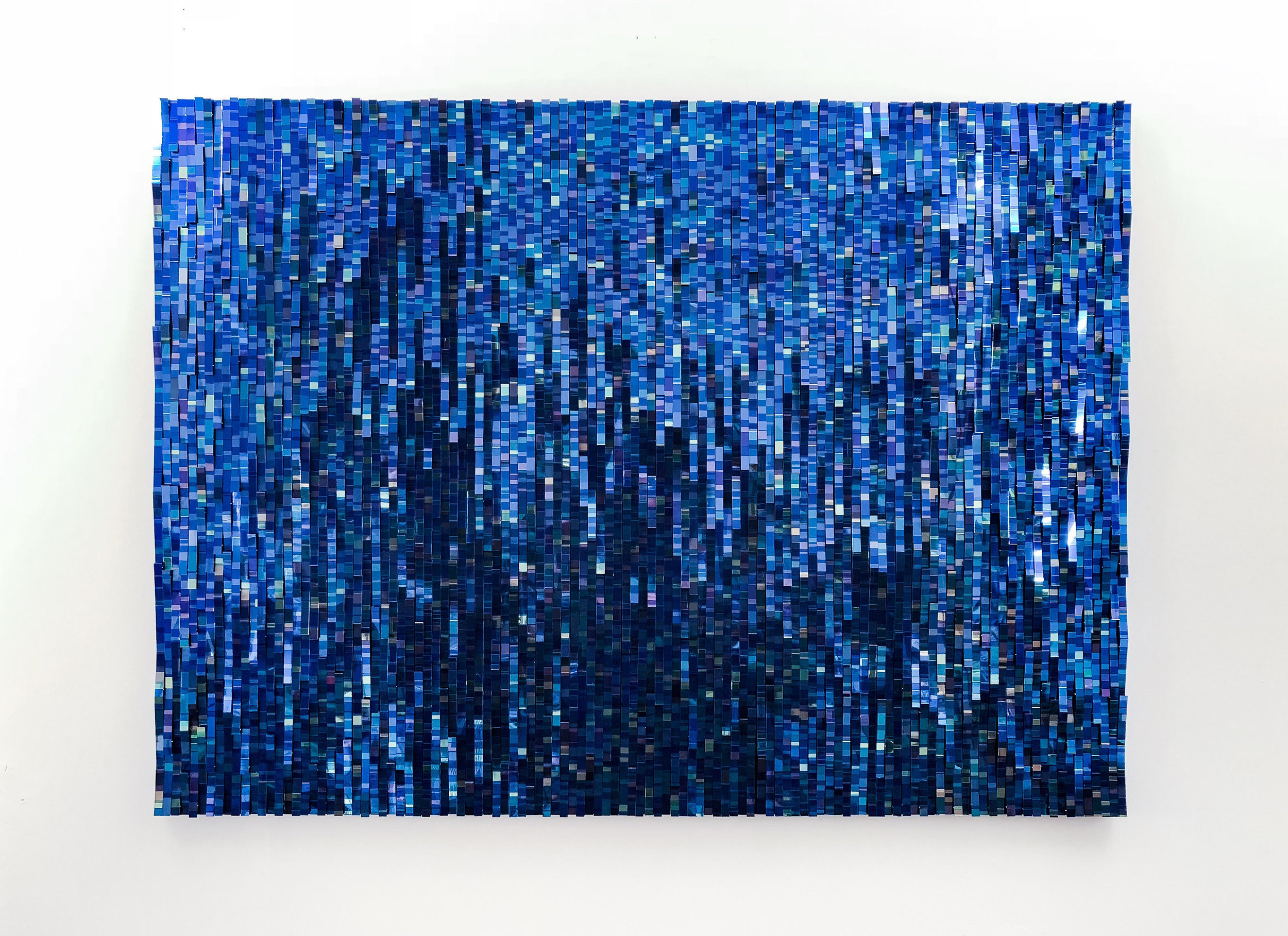 Blue Bits (2018), Mixed media on wood panel, 36 x 49 inches