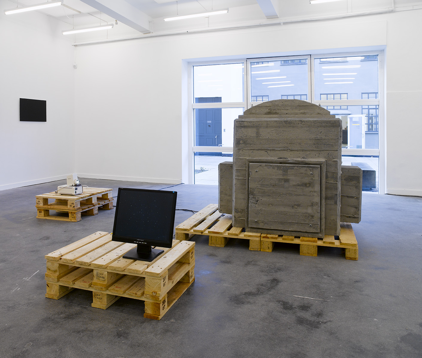 Dust champer As exhibited at Gallery Christina Wilson, DK. 2007 Materials: Concrete, wood, lamp, video camera, monitor, electric motor.