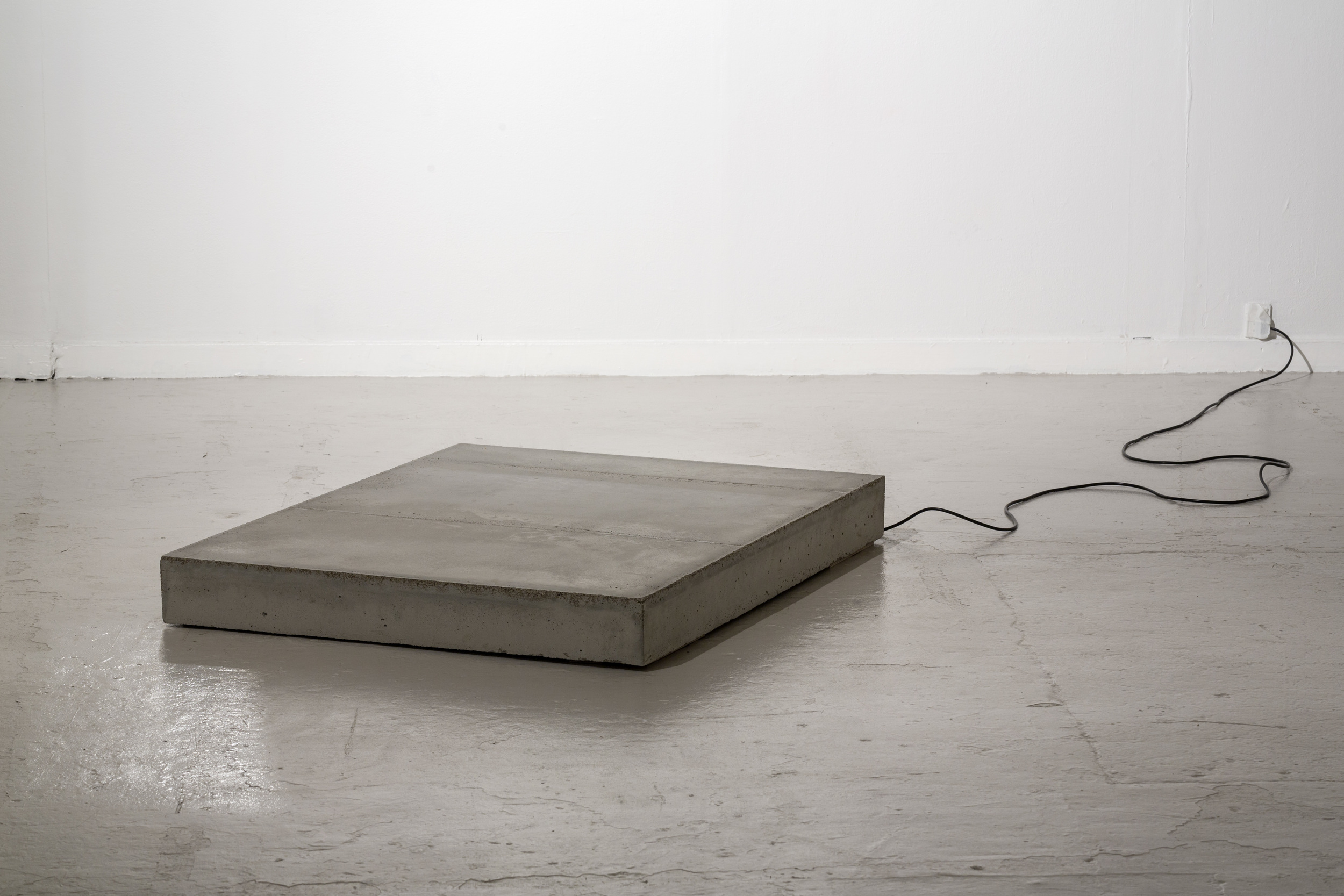 SELF-PORTRAIT, NAKED #11 Dimension: H: 13 cm W: 133 cm L: 100 cm Materials: Concrete, heating element, reinforcing steel.