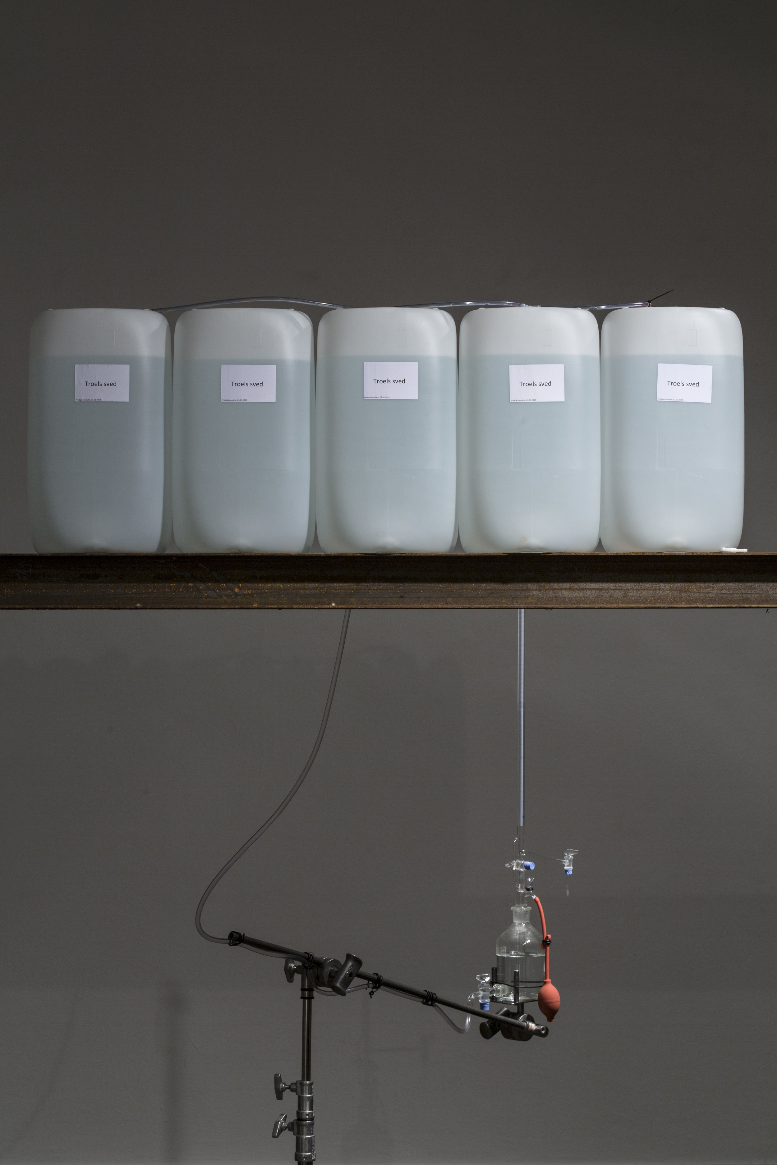 SELF-PORTRAIT, RESPIRATION AND PERSIRATION  Detail  Materials: Plastic cotainers, 120l of artificial sweat, iron beam, hoses, laboratory glas equiptment, aluminium plate, heating element, ventilator,glass, paper, wooden frame.