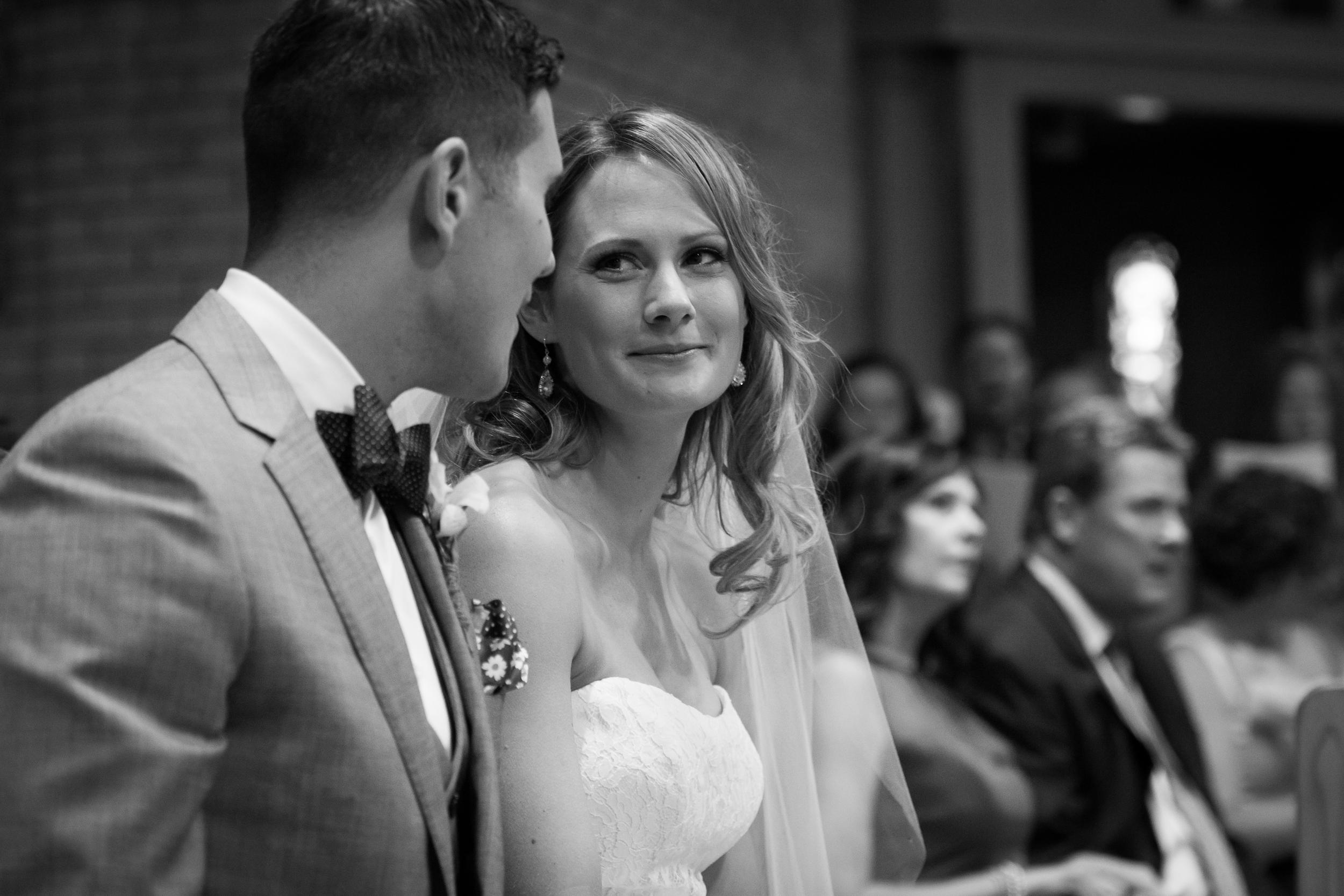 Wedding in church bride looking at groom