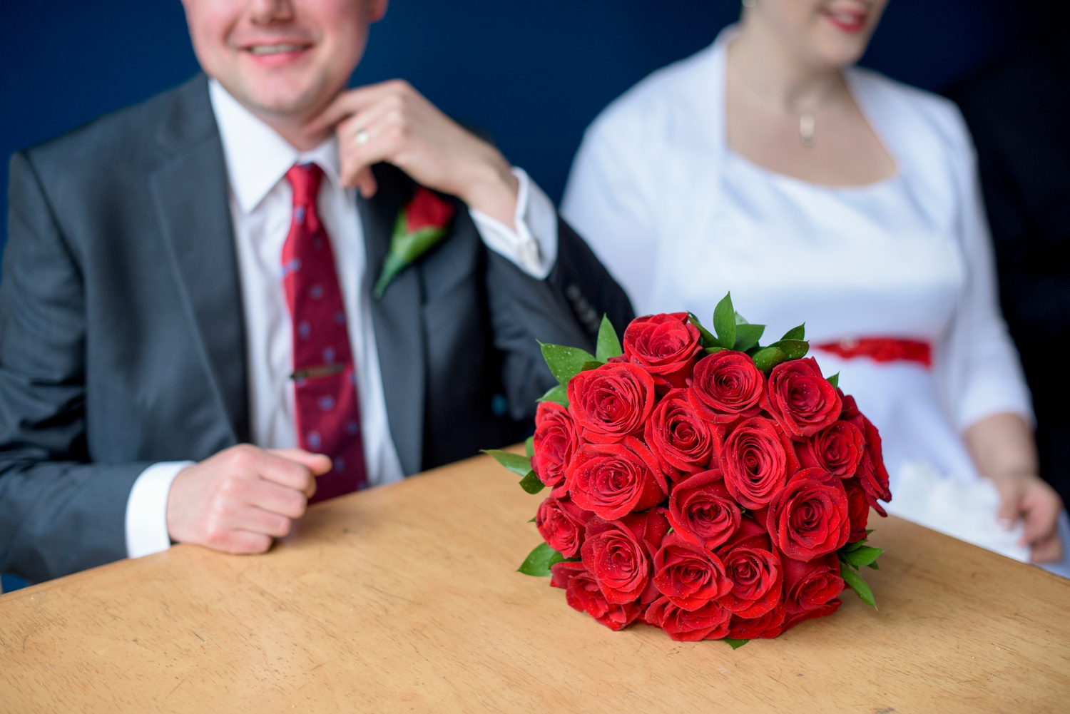 rose bouquet on the table in front of the bride and groom