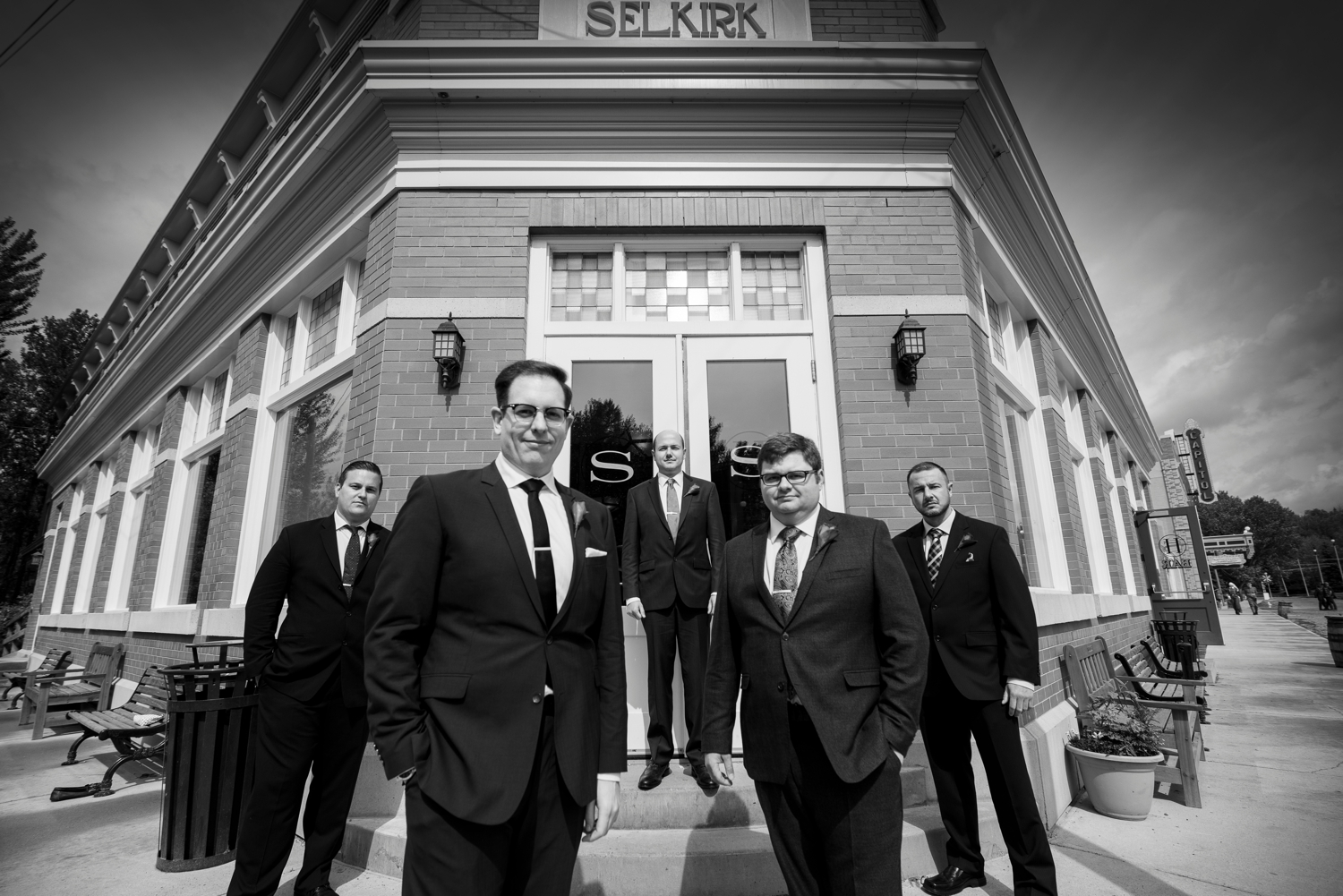 Groom and his groomsman in front of the Hotel Selkirk