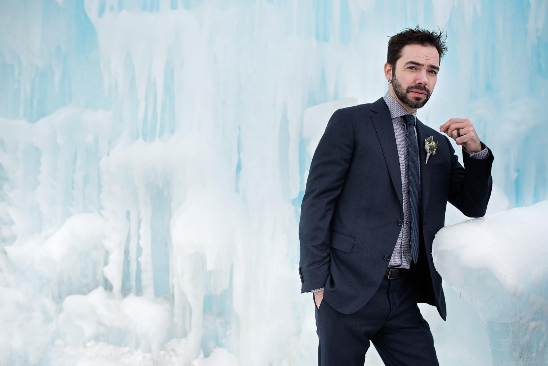 Married wedding groom in an ice castle