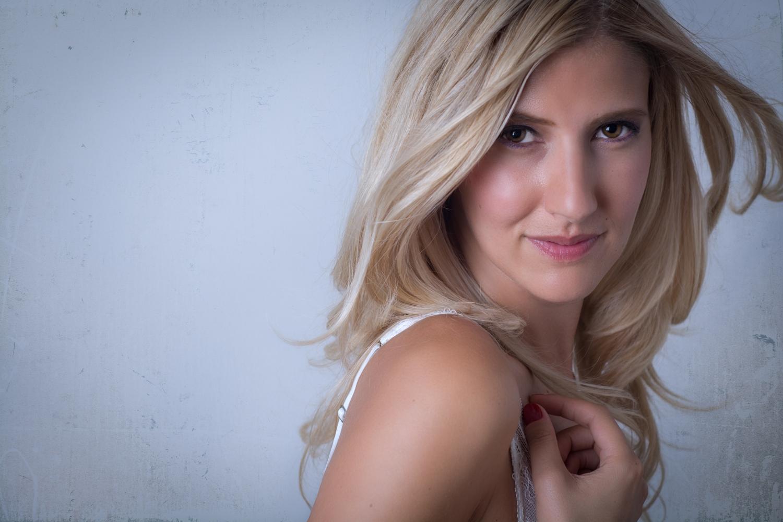 Boudoir closeup portrait of blonde woman