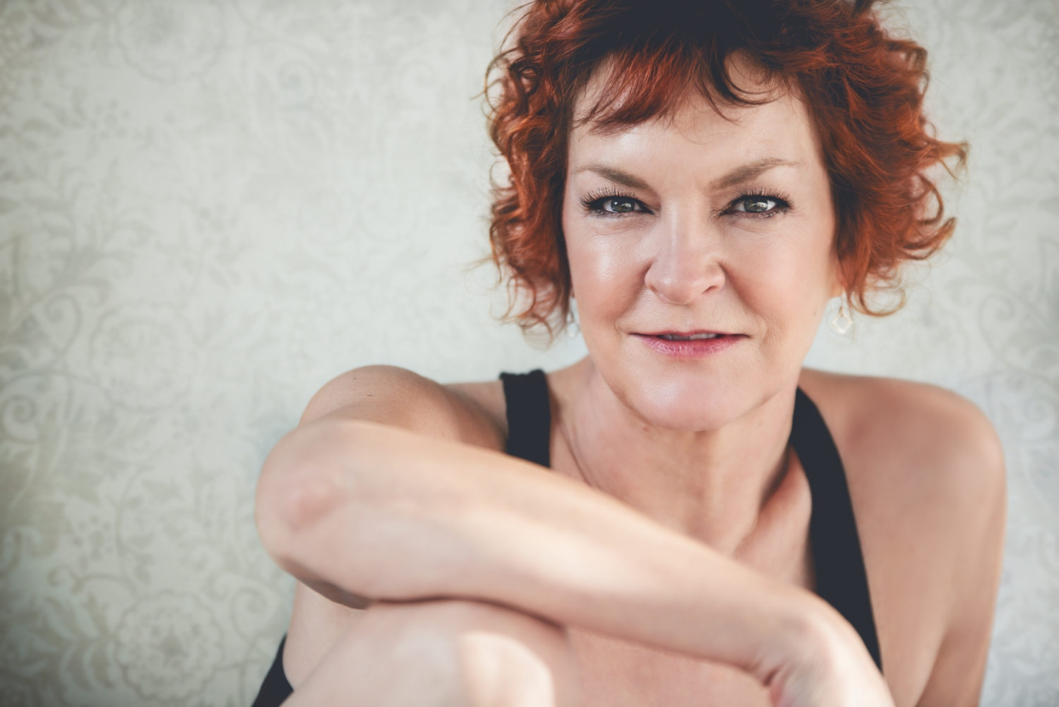 Boudoir portrait of woman over fifty years old with red hair