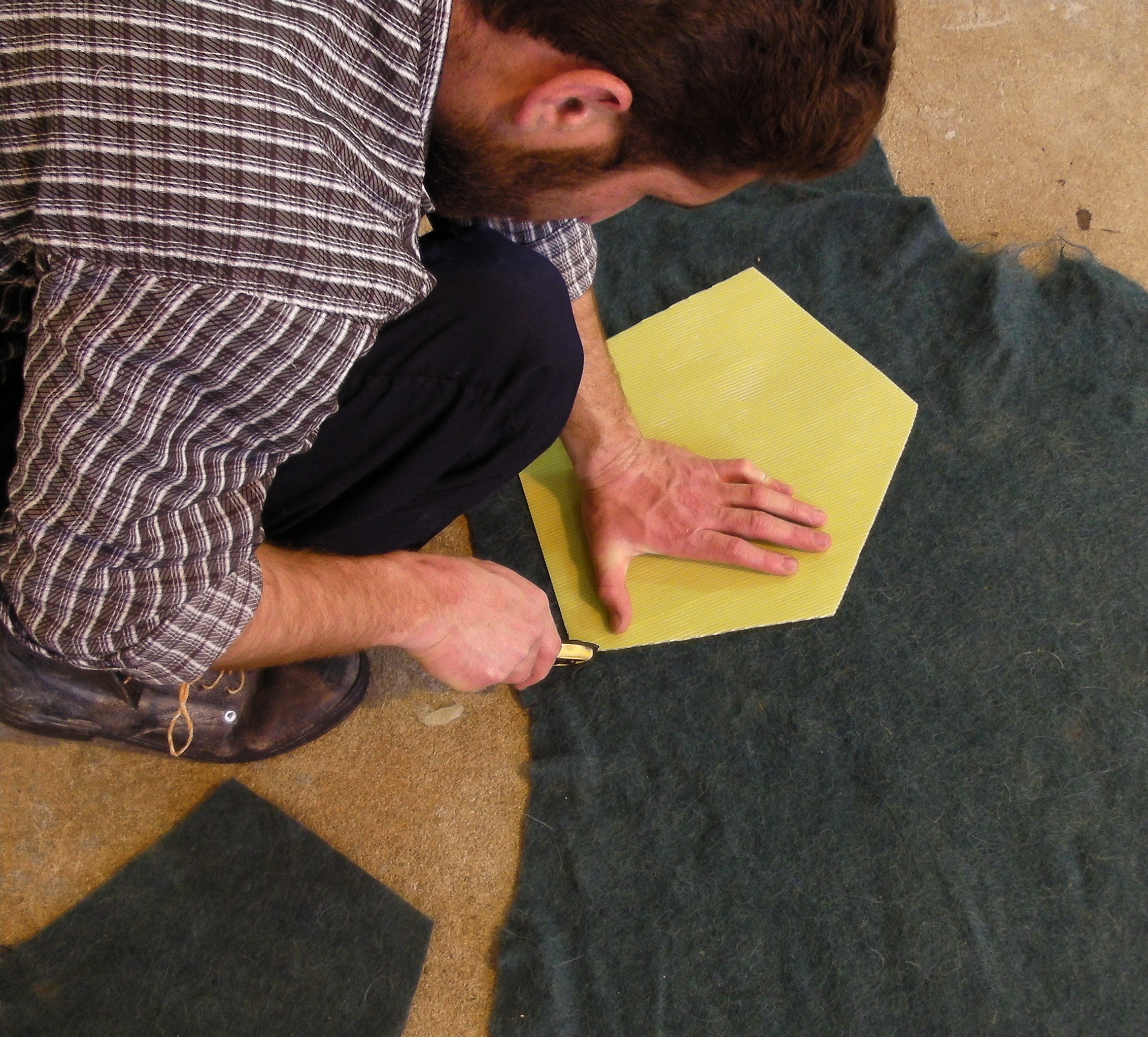 Cutting a pentagon for the Hive rug.