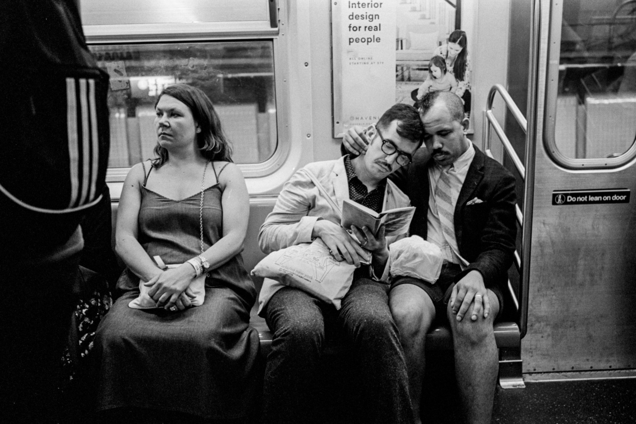 """I just love the way they're just kind of embracing in this open romance in the subway as he's reading this book,"" Mr. Wagner said. ""It almost looks like they're reading it together.""  (image via Andre D. Wagner for The New York Times)"